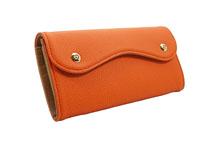 ドイツシュリンクを使用したオレンジ色のカブセ型長財布